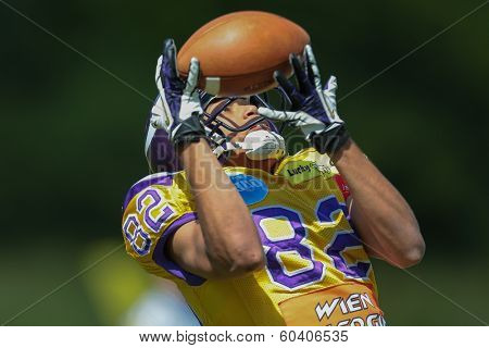 VIENNA,  AUSTRIA - MAY 26 WR Laurinho Walch (#82 Vikings) catches the ball during the EFL football game on May 26, 2013 in Vienna, Austria.