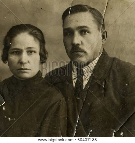 MOSCOW, USSR - CIRCA 1930s : An antique photo shows studio portrait of a mature man and a woman - a married couple.