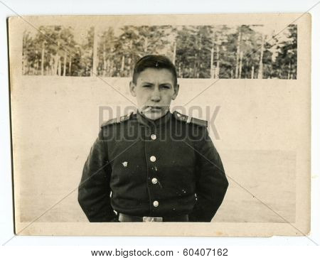 MOSCOW, USSR - CIRCA 1960s: An antique photo shows studio portrait of a Red Army soldiers, mechanic class in uniform.