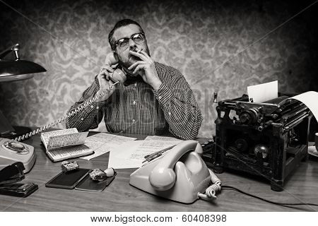 Man smoking a cigarette while talking on the phone 1960's scene