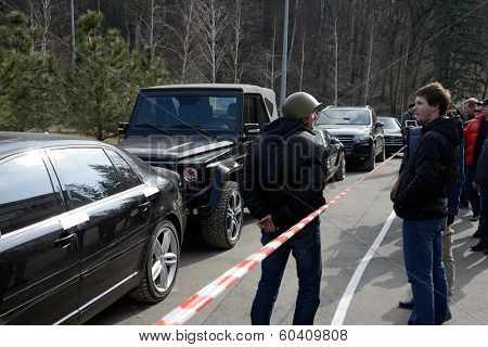 KIEV, UKRAINE - February 24, 2014: Mejigirya - residence of the ex president Yanukovich, now open for all. Confiscated cars