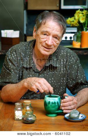 Senior Man Drinking Herbal Tea