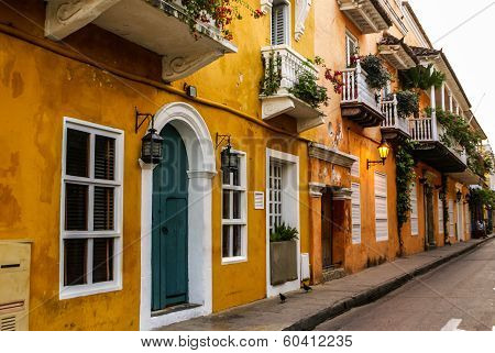 Typical Street Scene In Cartagena, Colombia Of A Street With Old Historic Colonial Houses