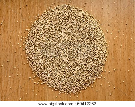 Dry yeast balls in wooden board table surface top view