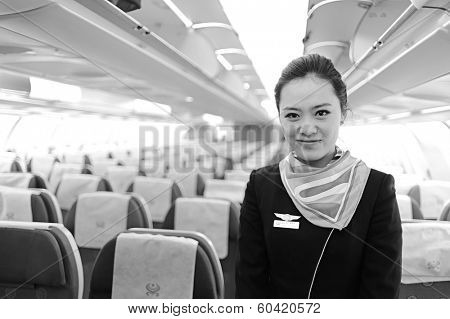 MOSCOW, RUSSIA - NOV 23, 2011: Hainan Airlines crew member in Airbus A330 in Moscow, Russia. Hainan Airlines Company Limited is an airline headquartered in Haikou