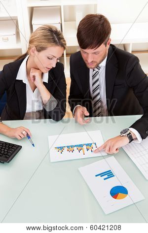Business Colleagues Discussing A Bar Graph