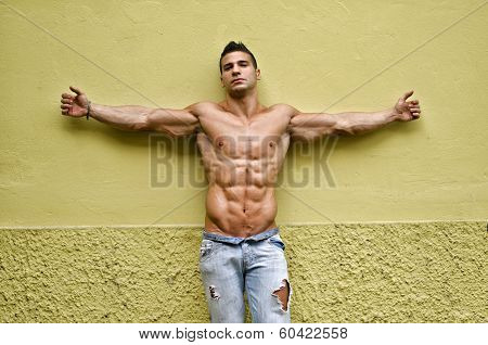 Handsome, Muscular Young Man Shirtless With Arms Spread Open