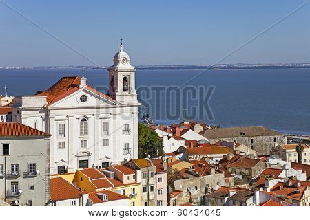 Alfama District with Santo Estevao Church and the Tagus River estuary seen from Miradouro de Santa Luzia. Lisbon, Portugal.