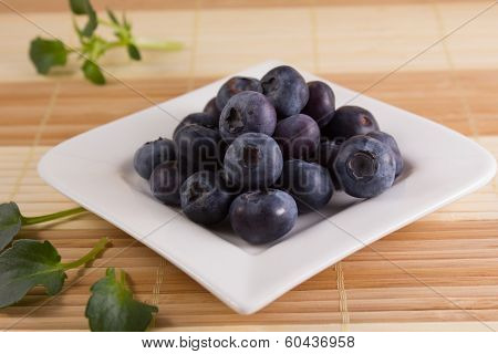 Tasty Bilberries On A Square-shaped Plate