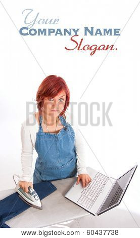 Woman with apron ironing and using her computer simultaneously