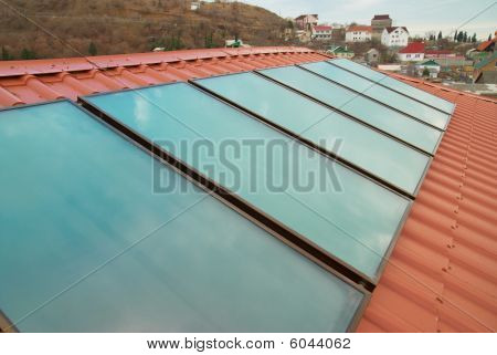 Solar Panel On The Red Roof.