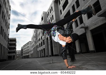 Hip-hop Dancer Girl Posing On The Deserted Streets