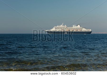 Cruiseship heading out at the sea
