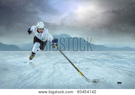 Ice hockey player on the ice in action.