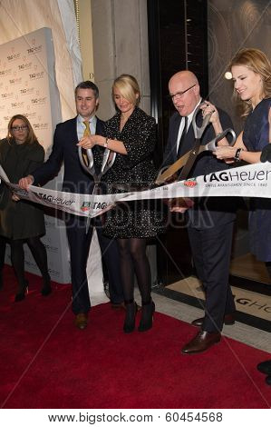 NEW YORK-JAN 28: (L-R) Jeffrey Fowler, Cameron Diaz, Stephane Linder and Amanda Spadaro at a ribbon cutting at the Tag Heuer Flagship Fifth Avenue store opening on January 28, 2014 in New York City.