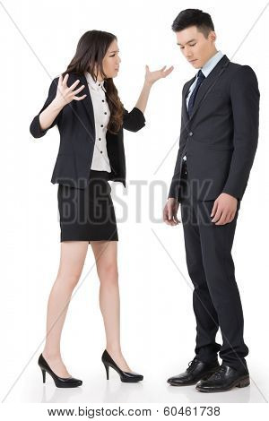 Angry business woman yelling to a man, full length portrait isolated on white background.