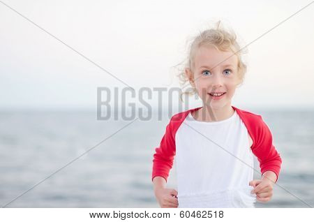 Little Girl Having Fun On Beach Vacation.