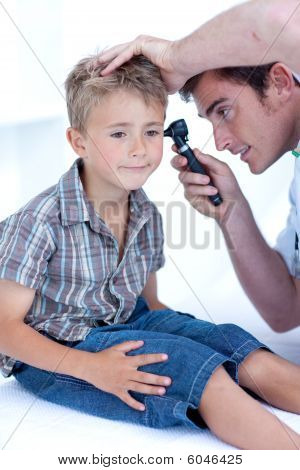 Doctor Examining A Patient' S Ears With A Otoscope