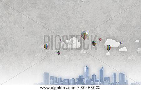 Urban scene with colorful aerostats flying in air