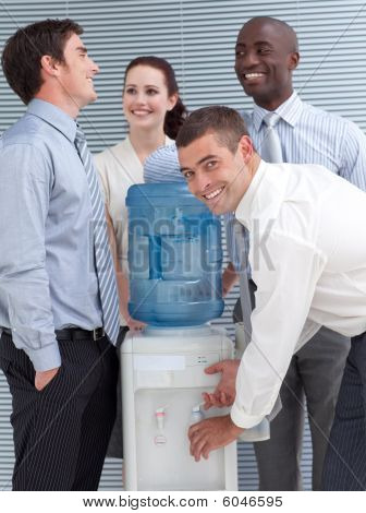 Busines Colleagues Talking Around Water Cooler