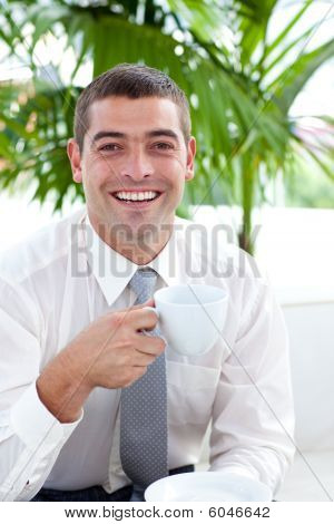 Businessman Drinking A Cup Of Tea In Workplace