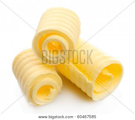 Curls of fresh butter, isolated on white