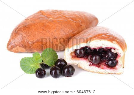 Fresh baked pasties with currant isolated on white