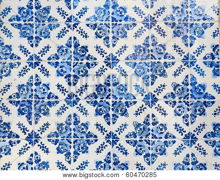 Traditional Ceramic Tiles On The Wall In The Street In Portugal