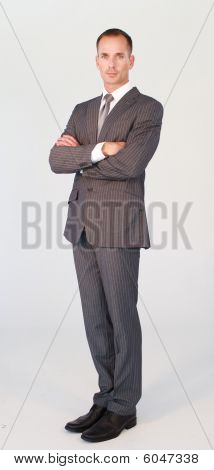Standing Confident Businessman Isolated Against White
