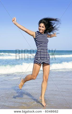 Beautiful Summer Brunette Girl Jumping On The Beach