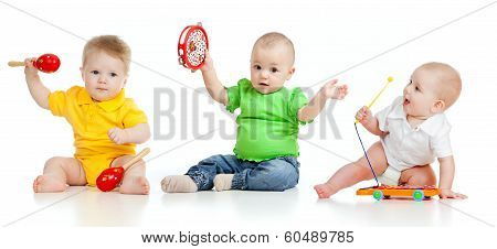 Babies Play Musical Toys. Isolated On White Background