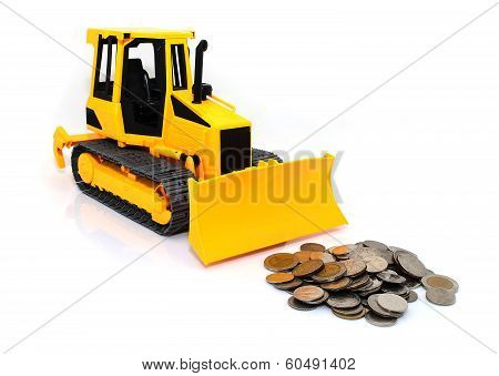 Yellow  Tractor And Coins Isolated Over White Background
