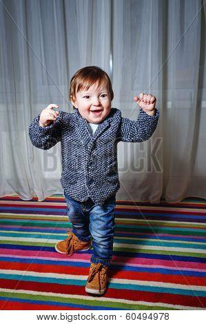 Little Boy Wearing A Jacket