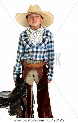 Serious Looking Young Cowboy Holding A Saddle In Chaps
