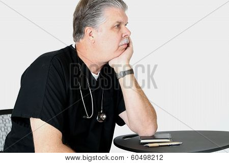 Medical Doctor Wearing Scrubs Bored Writing Scripts