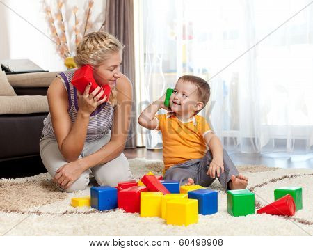 Cute Mother And Kid Boy Playing Together at home