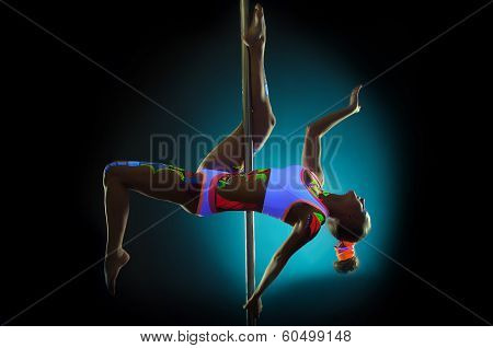 Graceful pole dancer with UV pattern on body