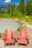 colorful chairs over fantastic mountain river view