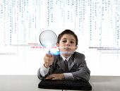 pic of maliciousness  - Young boy looking for malicious code of a virus - JPG
