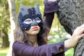 picture of catwomen  - Young beautiful caucasian girl wearing a cat mask - JPG