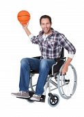 pic of paralympics  - Man in wheelchair with basketball - JPG