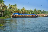 stock photo of houseboats  - landscape with houseboat in kerala backwaters India kerala - JPG