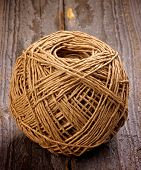 foto of hasp  - Ball of String Linen Twine isolated on Rustic Wooden background - JPG