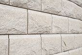 stock photo of cinder block  - background of natural brown stone block wall - JPG