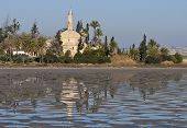 foto of larnaca  - Hala Sultan Tekke or Mosque of Umm Haram is a Muslim shrine on the west bank of Larnaca Salt Lake in Cyprus - JPG
