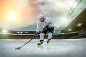 stock photo of ice hockey goal  - Ice hockey player on the ice - JPG