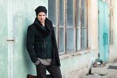 image of knitted cap  - young fashion man posing outdoor - JPG