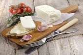 stock photo of home-made bread  - home made cheese and slice bread with butter on a wooden board - JPG