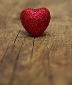 stock photo of heartfelt  - Red heart on a background of wood - JPG