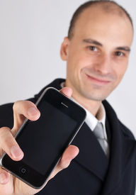 pic of mobile-phone  - happy business man holding a mobile phone - JPG